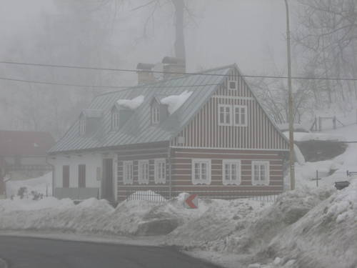 Mountain cottage in a fog